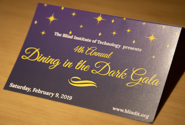 Dining In the Dark 2019 Invitation with a purple background and yellow stars