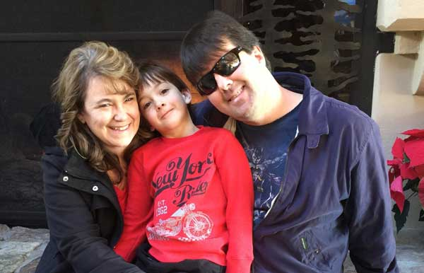 Mike and Natalie Hess smiling with their son, Maddy.