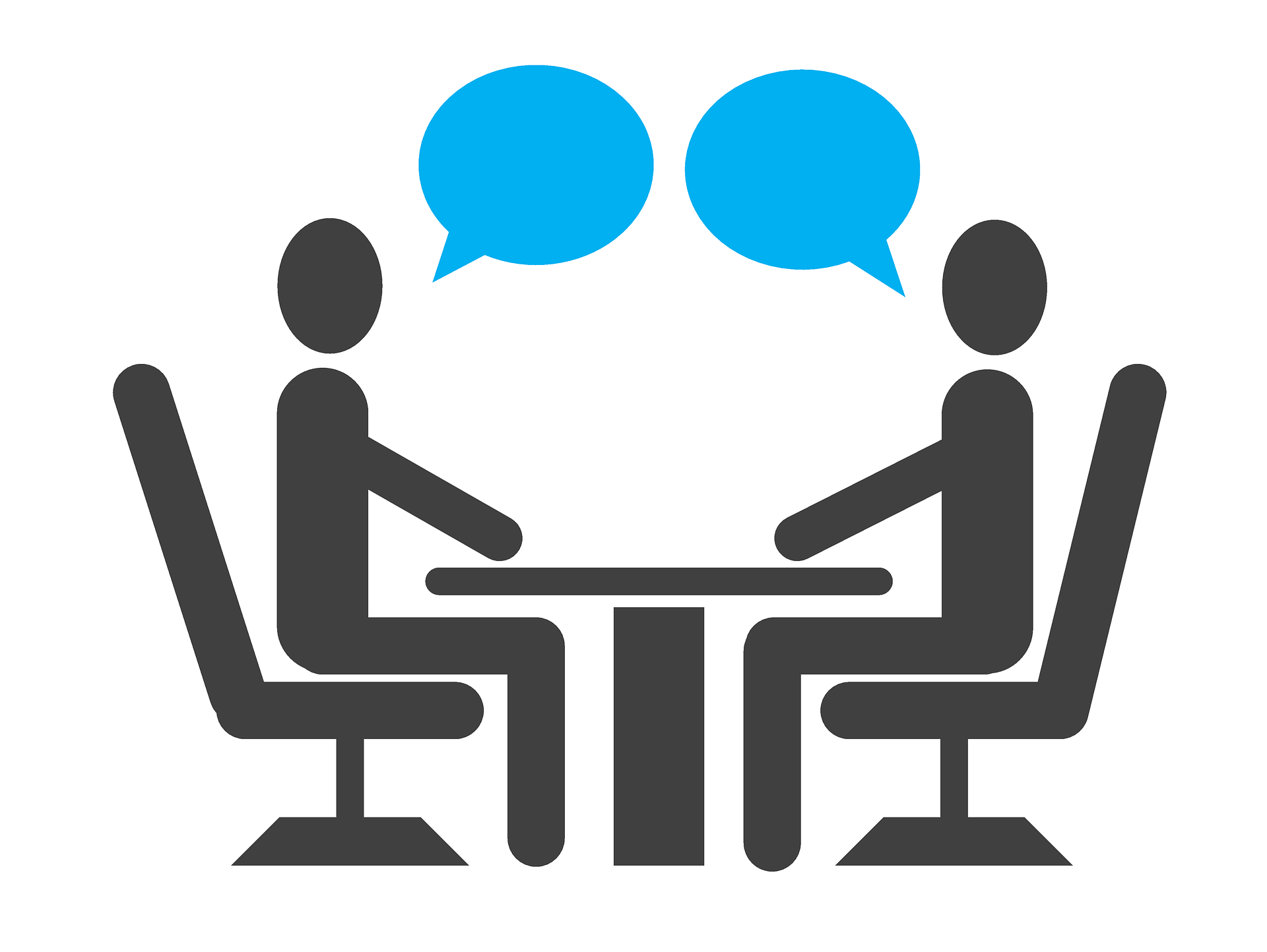 Image is of two people sitting and talking at a table