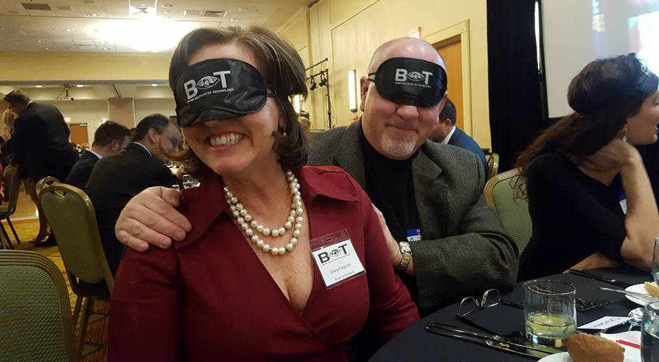 Image is of Diana and her husband wearing BIT eye mask/blinders